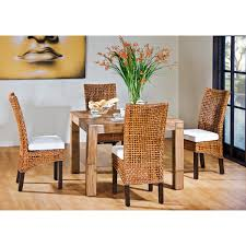 beautiful rattan dining room chairs set and wood table in a dining from the beauti of