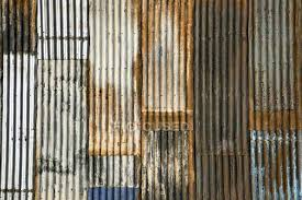 full frame shot of rusted corrugated metal surface stock photo rusty fence