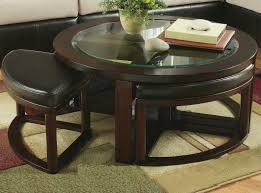 dark brown traditional wood and glass round coffee table with stools to complete living room designs