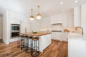 white kitchen island with butcher block