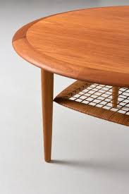 round coffee table in teak with rattan shelf