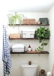 across bath shelf spots to sneak in a little more shelf storage apartment therapy bathroom storage