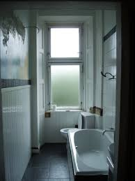 bathroom window glass. Frosted Glass Privacy Bathroom Window Treatments With Toilet And Built In Bathtub Minimalist