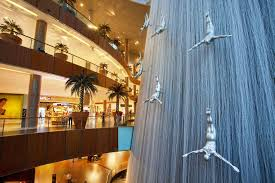 waterfall and sculptures of diving men inside dubai mall the largest ping mall in the