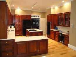 Kitchen Cherry Cabinets Hickory Floors Cherry Cabinets Black Appliances And Light Floor