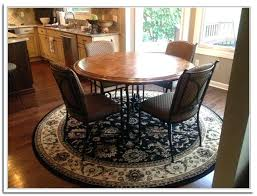 area rug under round dining table size kitchen sink beacon