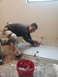 who makes the best tile leveling system 548407 404687772875047 1664451591 n jpg