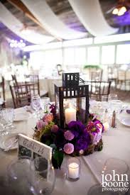 I like these centerpieces - without thr lavender // Purple and lavender  wedding reception centerpiece by Floral Fields of Burbank, California.