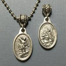 this is for a beautiful silver tone catholic 3 4 inch oval medal with saint michael the archangel in the front of the pendant and the guardian angel on