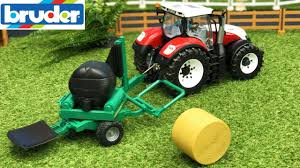 bruder toys farming tractor steyr and balewrapper in action video for kids