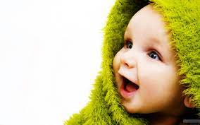 Wallpaper Laughing baby in a green ...