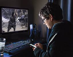 students beware illegal ing on campus is risky ca a student watches game of thrones on his computer photo illustration by levi nicholson