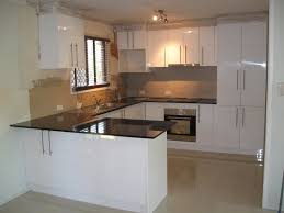 nice kitchen track lighting interior decor. Shaped White High Gloss Lacquer Finish Kitchen Cabinets With Black Granite Countertop As Well Glazed Cream Floor Tiles Plus Nice Track Lighting Decor Interior E