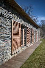 exterior porch shade like these sliding shutters as a shade option for summer on north facing exterior porch shade