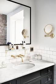 bathroom mirror scratch removal malibu ca youtube: beautiful black and white bathroom with brass sink faucet white subway tiles and painted