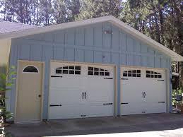 solid color stain new garage doors and entry door