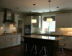 modern drum shape pendant lamps over granite top kitchen