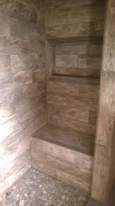 Master Shower with bench and window for soap/shampoo. River rock floor,  along