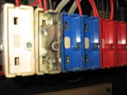smlpx mechanoids fuseholders fuseholders for cartridge wire fuses in old 1960s domestic electricity distribution unit fuse box white blue red closeup 2 dhd jpg d 2008 03 27 mar 27