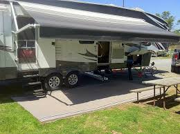 outdoor rv mats help to hold some of the debris that people carry on their shoes as they move in and out of the vehicle and around the campground
