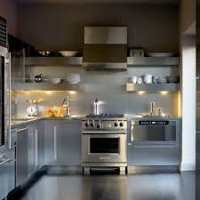 backsplash lighting. industrial style kitchen using silver cabinets and stainless steel backsplash featuring open shelves with under lighting h