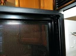 clean inside glass oven door cleaning between the mesh screen and glass door on microwave cleaning glass oven door with bicarbonate of soda