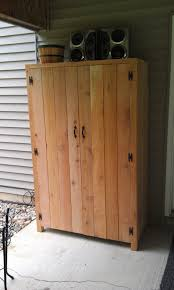 black wood storage cabinet. Cabinet Fantastic Outdoor Cedar Storage With Black Butterfly Wood Cabinets Wall Doors Furniture Shelves Lockable