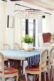 rustic dining e with a large table a chandelier and wooden dining chairs