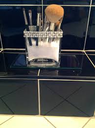 makeup brush holder beads. filled with the clear vase filler beads, put some brushes in and voila! this makeup brush holder beads b