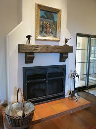 Railroad Tie Mantle natural stone ledge wood beam and fireplace from stoneselex 7274 by xevi.us