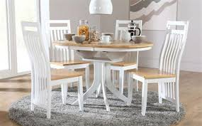 hudson round two tone extending dining table with 4 bali two tone chairs