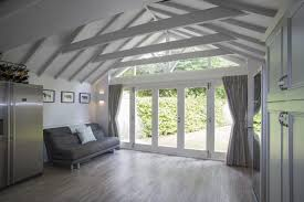 accoya bi fold doors and apex selected for berkshire cottage