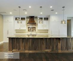 white cabinets with a walnut kitchen island kitchens islands antique butcher block top