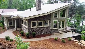 House Plan at FamilyHomePlans comContemporary Craftsman Modern Prairie Style House Plan Elevation
