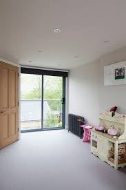 Rear dormer | Juliet balcony | Modern glass balustrade and sliding bedroom  doors | Garden views