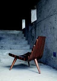 cardboard chair design with legs. Modren Legs Steamed Wood Three Legged Design Chair Against A Concrete Background Throughout Cardboard Chair Design With Legs A