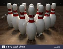 Antique Wooden Bowling Game An arrangement of white and red used vintage bowling pins resting 40