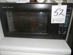 sharp carousel microwave. lot # : 52 - sharp carousel microwave, 1998, 1100 watts microwave a