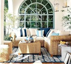 coastal outdoor space with a cozy seating set up and eclectic rug rugs round beach