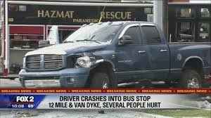 Pickup truck crashes into bus stop in Warren injuring several people ...