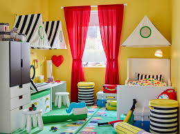 colourful circus themed children s room with yellow walls red curtains and an extendable bed