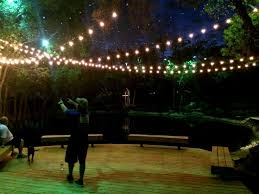dallas landscape lighting installing string lighting for an outdoor wedding in dallas tx call