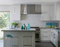 modern white kitchen wall cabinet with 2 pendant lamps over kitchen island with table accessories and undermount kitchen sink