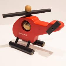 swiss heli a handcrafted wooden toy helicopter designed by peter schweizer