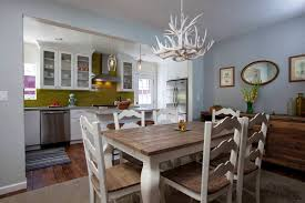 rustic dining room with white antler chandelier