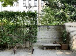 a privacy screen is one of our favorite garden s fixed or portable partitions with slats grids lattices and translucent fabrics will block prying