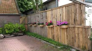 Introduction: A Pallet Fence With Flower Boxes and Bee Hotels