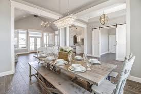 light rustic dining room table with bench seating in large dining rooms space long chandelier