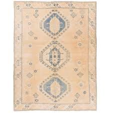 vintage anatolian rug in salmon pink cream and light blue colors for