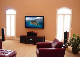 flat screen tv on wall with surround sound. flat screen tv install on wall in living room tv with surround sound